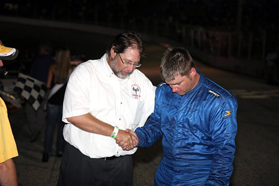 Todd prays with Jeremy Lepak (Photo Credit: Mark Melchiori)