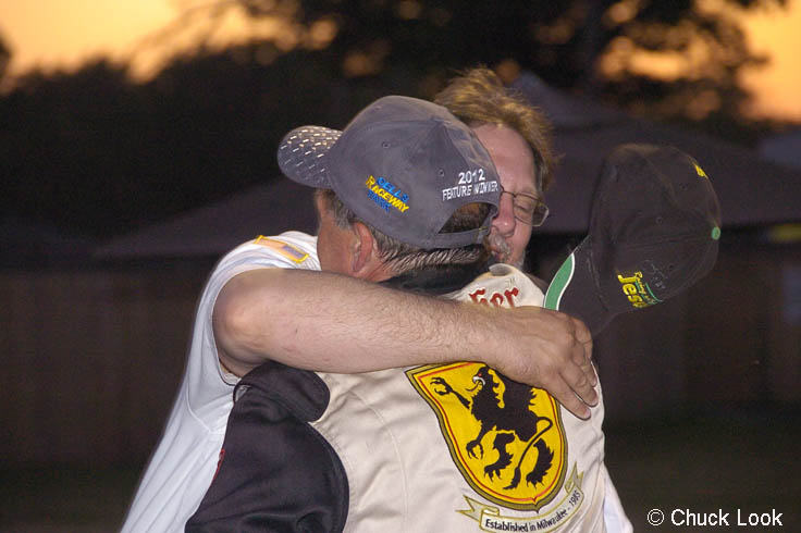 Todd praying with Lyle Nowak after his win at the Dells, 2012.