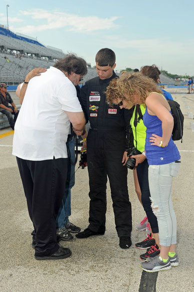 Todd praying with driver, family , and crew at Milwaukee Mile 2013